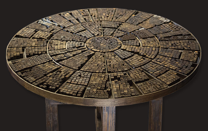 Image of Chinese characters on top of a circular wooden platform.