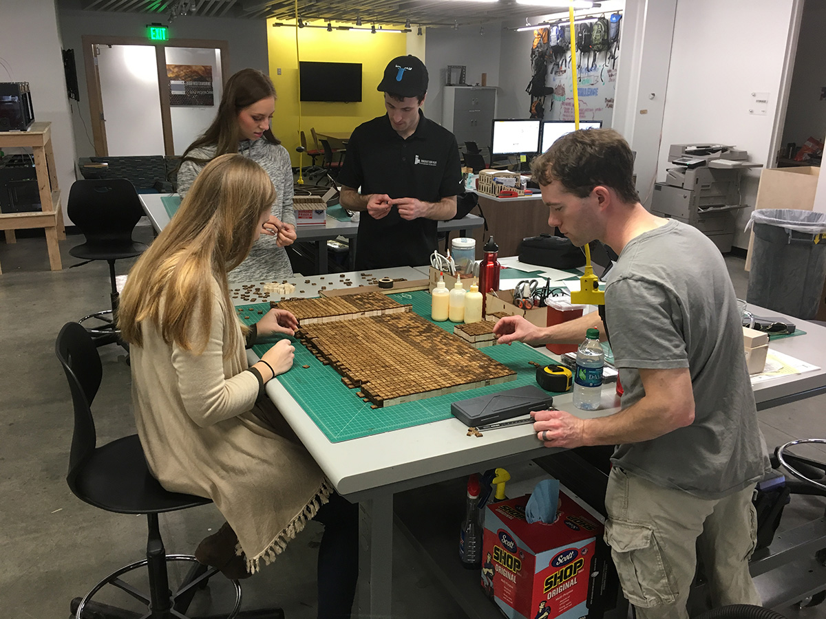 Students and staff at the iHub working on the Song Dynasty English printing table.